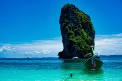 A long tail boat anchored at Po Koda beach. A very popular island beach in the Andaman Sea Stock Photography