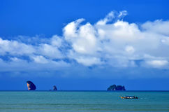 Long tail boat in Ao Nang bay with islets in the background Stock Photography