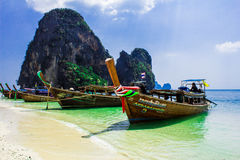 Long tail boat on the beach. Sun sea mountains and blue sky Stock Photo