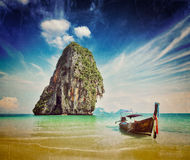 Long tail boat on beach, Thailand. Retro vintage hipster style image of tropical vacation holiday beach concept - Long tail boat on tropical beach, Krabi Royalty Free Stock Photo