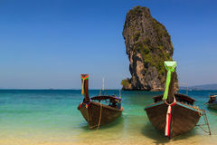 Long tail boat on the beautiful beach and beauty blue sky , poda royalty free stock photos