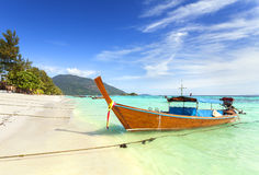 Long tail boat at a beautiful beach, Thailand Stock Photos