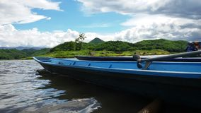 Long tail boat. Blue boat in the reservoir Royalty Free Stock Image