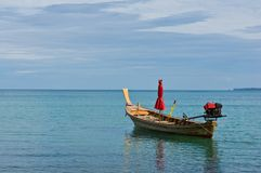Long tail boat and blue sky Royalty Free Stock Photo