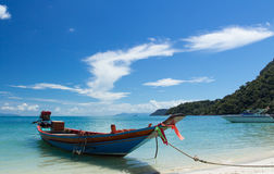 Long Tail Boat in Clear Water and Blue sky Stock Images