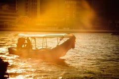 Long-tail boat. Driver on Chao phraya river,Bangkok ,Thailand stock photo