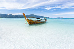 Long-tail boat floating on crystal clear sea water at tropical i Royalty Free Stock Image