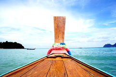 Long-tail boat front in the sea Royalty Free Stock Photo