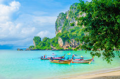 Long tail boat and high palm trees, Krabi Thailand Royalty Free Stock Images