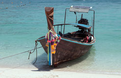 Long-tail boat, Koh Phi Phi,Thailand. A colorfully decorated long-tail boat in turquoise water in touristic town of Koh Phi Phi,Krabi Province,Thailand Stock Photos