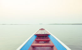 Long tail boat in lake Stock Images