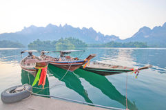 Long-tail boat and lakeside raft houses on Cheow Lan Lake, Khao Stock Photography