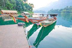 Long-tail boat and lakeside raft houses on Cheow Lan Lake, Khao Stock Image
