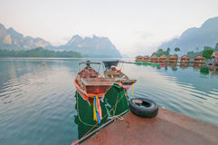Long-tail boat and lakeside raft houses on Cheow Lan Lake, Khao Stock Photos