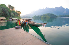 Long-tail boat and lakeside raft houses on Cheow Lan Lake, Khao Stock Images