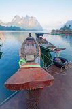 Long-tail boat and lakeside raft houses on Cheow Lan Lake, Khao Royalty Free Stock Images