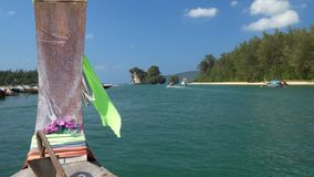 Long tail boat left port nopparat thara beach heading to poda island ,Krabi Thailand. stock footage