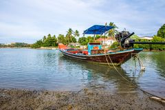 Long-tail boat of local Thai fisherman parked in the bay.  Royalty Free Stock Photo