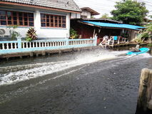 Long tail boat making water distribution Stock Photo