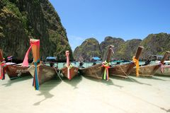 Long Tail Boat at Maya Bay, Krabi, Thailand. Crystal Clear Waters, Clear Skies and Perfect Scenery. A long tail boat sits in Maya Bay, Koh Phi Phi Ley stock photos