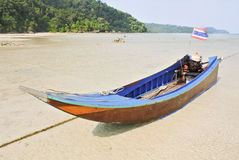 Long tail boat. Mooring at the sand beach in thailand stock photos