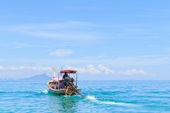 Long-tail boat moving on the sea Royalty Free Stock Images