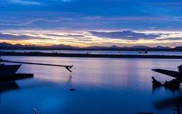 The long tail boat park on the river at dusk Royalty Free Stock Photography