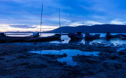 The long tail boat park on the river at dusk Royalty Free Stock Photos