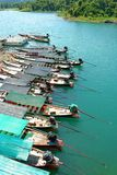 Long-tail boat parked. In a row to stay Chiew Lan Dam. Surat Thani Province royalty free stock images