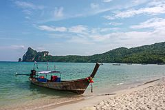 Long tail boat at Pi Pi island beach with blue sea mountain and. Sky, Thailand stock image