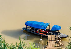 Long Tail Boat ready so sail - Mekong River. Upper view of a longtail boat ready so sail on Mekong River at Luang Prabang, Laos Royalty Free Stock Photo
