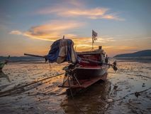 Long tail boat on the sand by the sea royalty free stock image