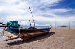 Long-Tail Boat On The Shore (Chumphon, Thailand). The long-tail boat was wooden that is main equipment to fishing of Asian fisherman Stock Photography
