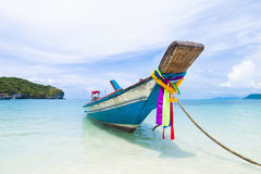 Long tail boat sit on the beach Royalty Free Stock Images