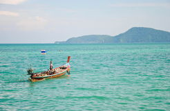 Long tail boat sit on the sea, Phuket island, Thailand Royalty Free Stock Image