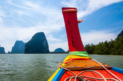 Long-tail boat in southern Thailand. View of limestone karsts from a long-tail boat in Phang Nga Bay, southern Thailand Stock Images