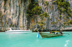 Long-tail boat, speedboat, rocks and sea, Thailand Royalty Free Stock Photography