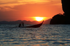 Long tail boat at sunset Stock Photos