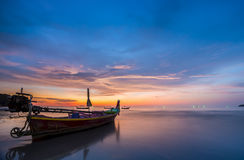 Long tail boat at Sunset on the beach of Ao Nang in Krabi Thaila. Nd Royalty Free Stock Photo