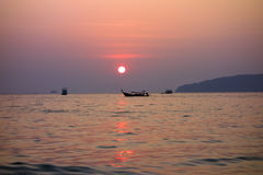 Long-tail Boat at Sunset. Stock Photo