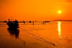 Long-tail boat in the sunset Stock Photo