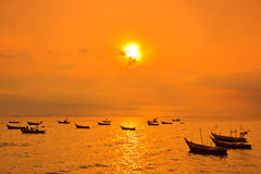 Long-tail boat in the sunset Royalty Free Stock Photos