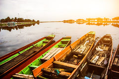 Long tail boat in Thailand& x27;s muddy clear waters with morning sunshine. Royalty Free Stock Image