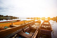 Long tail boat in Thailand& x27;s muddy clear waters with morning sunshine. Stock Image