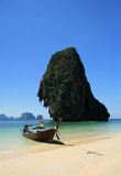 Long tail boat on tropical beach Stock Image