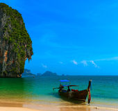 Long tail boat in tropical beach stock image