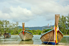Long tail boat on tropical beach, Krabi, Thailand Stock Photos