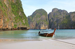 Long tail boat on tropical beach with limestone rock, Krabi, Thailand Royalty Free Stock Images