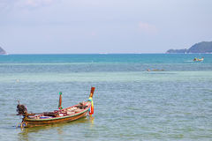 Long tail boat on tropical beach with limestone rock, Phuket, Thailand Royalty Free Stock Photos