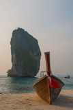 Long tail boat on tropical beach with limestone rock. Sunset, island Taming. Krabi, Thailand. Royalty Free Stock Photo